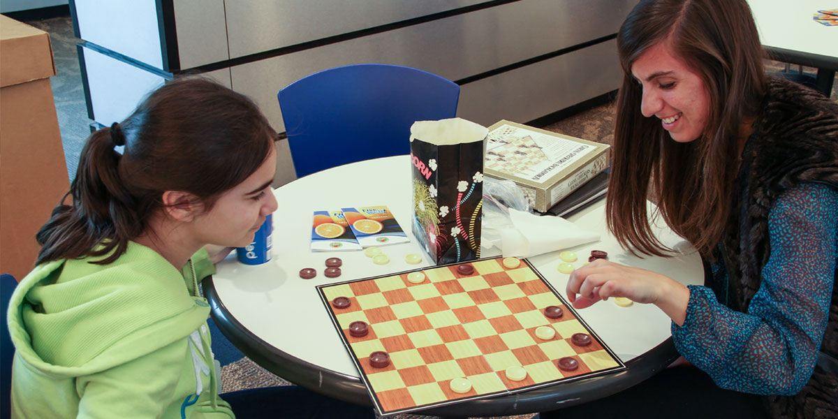Two people playing checkers